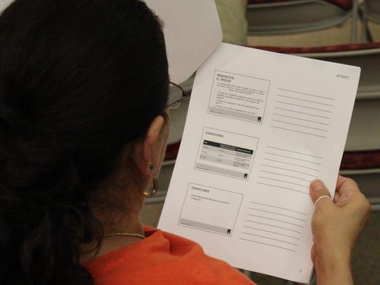 A woman attending an introductory citizenship class