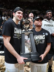 Purdue guards Dakota Mathias (31) and P.J. Thompson