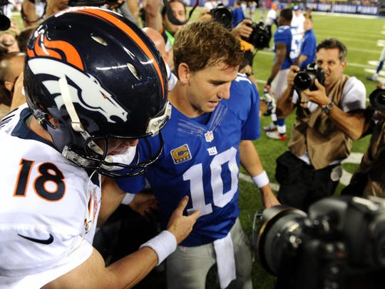 New York Giants Eli Manning shakes hands with older