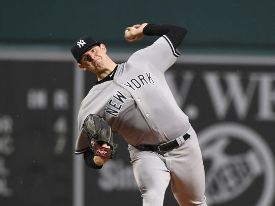 Jordan Montgomery delivers a pitch against the Red