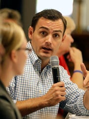 Mike Gallagher, Republican candidate for the 8th Congressional District, meets with area veterans Thursday at Stadium View Bar and Grille to discuss concerns they'd like to see addressed if he is elected to office.