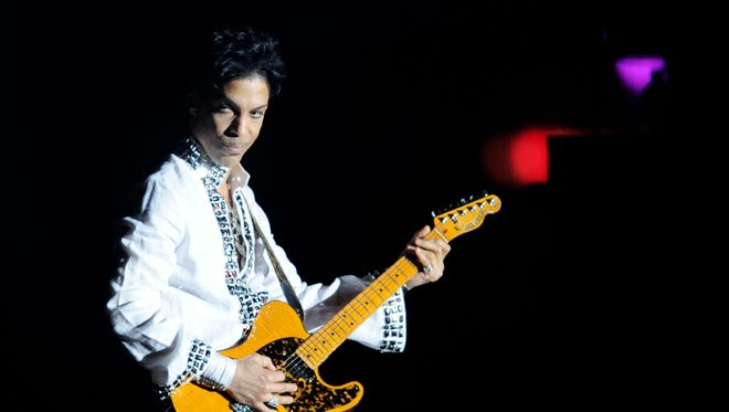 Prince performs during his headlining set at Coachella Valley Music and Arts Festival in Indio, Calif.,  April 26, 2008.