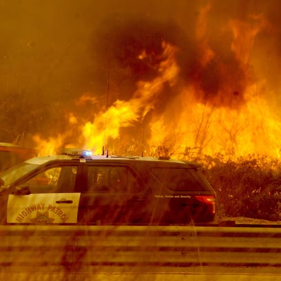 The Thomas Fire burns near Highway 101 in Ventura,