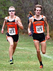 Northville's Conor Naughton (right) and Ben Cracraft (left) placed fourth and fifth, respectively, at the Division 1 regional.