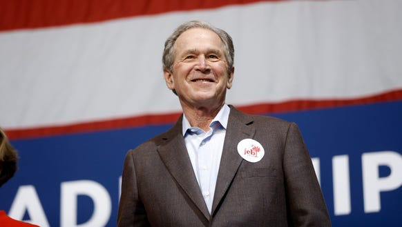 Former president George W. Bush campaigns for his brother,