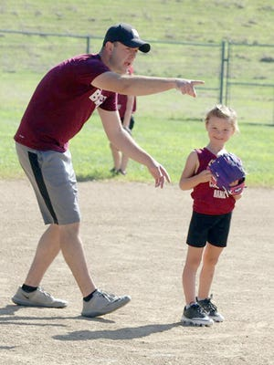 Citizen's Community Bank player Emryn Crawford gets some good advance from her dad during a Babe Ruth 6Usoftball game last Saturday at Lions Park. Mad Services defeated Citizen's Community Bank in a close game 7-5.