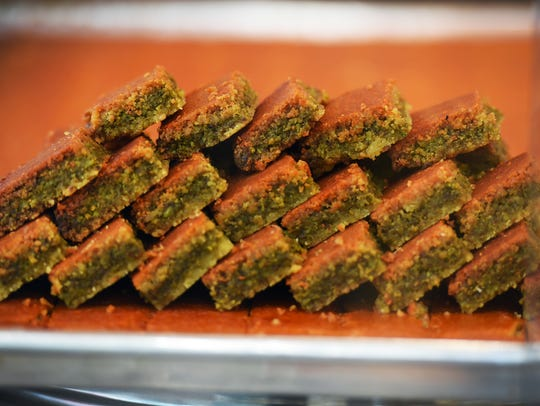 A plate of Arabian sweets are seen in a showcase at