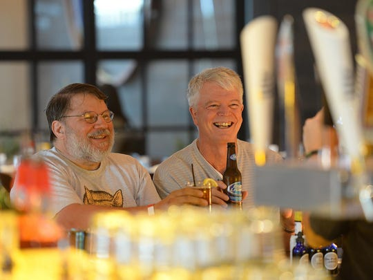 Drinking what they believe is the first drinks ever served at 1919 Kitchen & Tap are John Butitta, left, of Neenah and Jon Green, who came from Colorado for the opening of the eatery.
