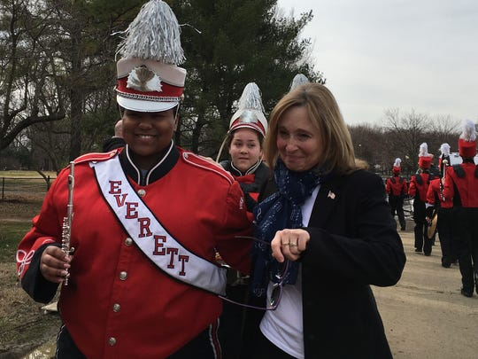Everett high school ninth grade Viking band member Olivia Hodge, of Lansing, left, gets a congratulatory hug from band director Penny Filoczuk after the band performed as part of pre-inaugural ceremonies at the Lincoln Memorial in Washington D.C. Thursday Jan. 19, 2017.