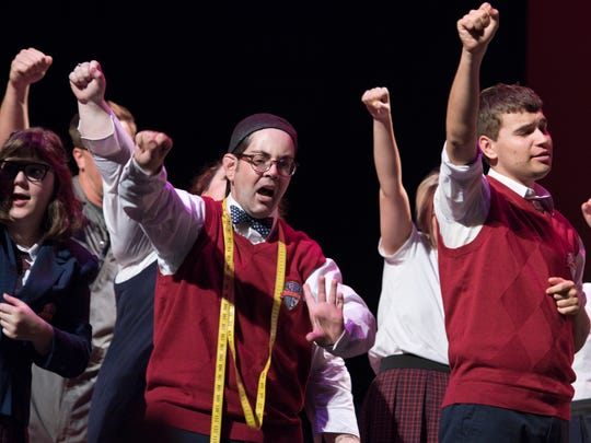 """Detour Company Theatre actors (center left to right) Justin Beyda and Chris LaBrie sing """"Stick it to the Man"""" at the Scottsdale Center for the Performing Arts."""