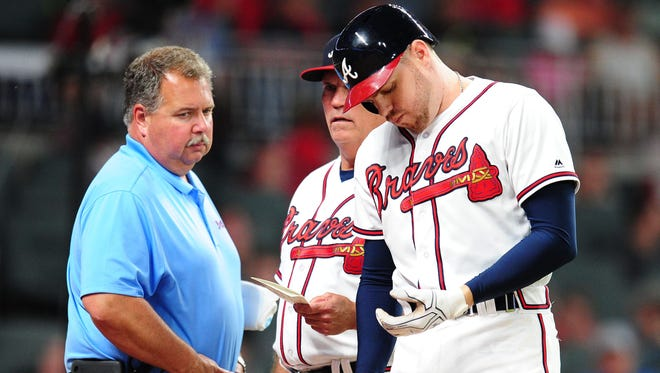 Freddie Freeman, right, leaves Wednesday's game after being hit on the hand by Blue Jays reliever Aaron Loup. He's expected to miss at least 10 weeks.