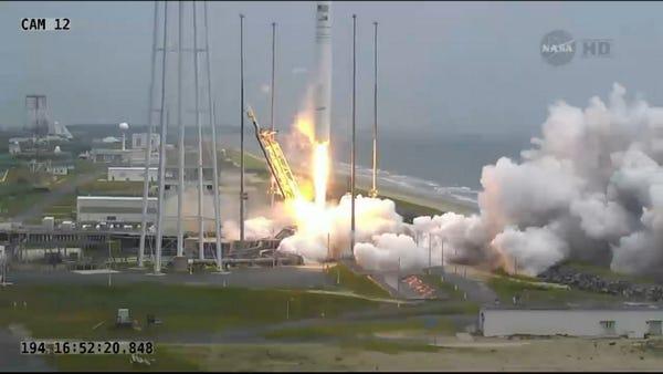 An Orbital Sciences Corp. Antares rocket and Cygnus cargo ship blast off from Wallops Island, Va., today at 12:52 p.m.