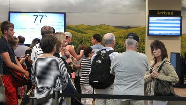 Travelers line up at the Westchester County Airport Aug. 19, 2014.