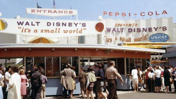 """Disney shows people at the """"it's a small world"""" attraction from the 1964 World's Fair in New York."""
