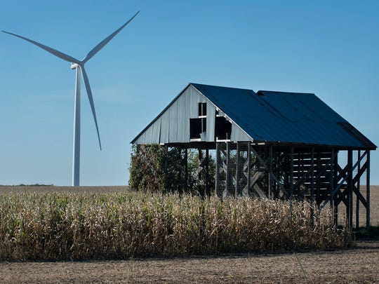 An old barn is seen next to a wind turbine Thursday at the Highland Wind Farm at O'Brien County near Primghar.