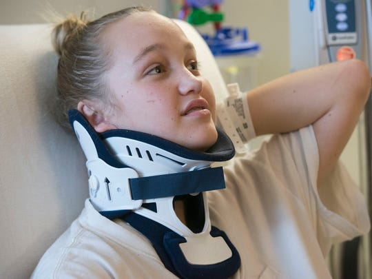 Abbi Barninger recovers at Sacred Heart Hospital Wednesday morning. Barninger, and her grandfather, were injured after the vehicle two were in was struck during a chase involving stolen car Saturday morning.