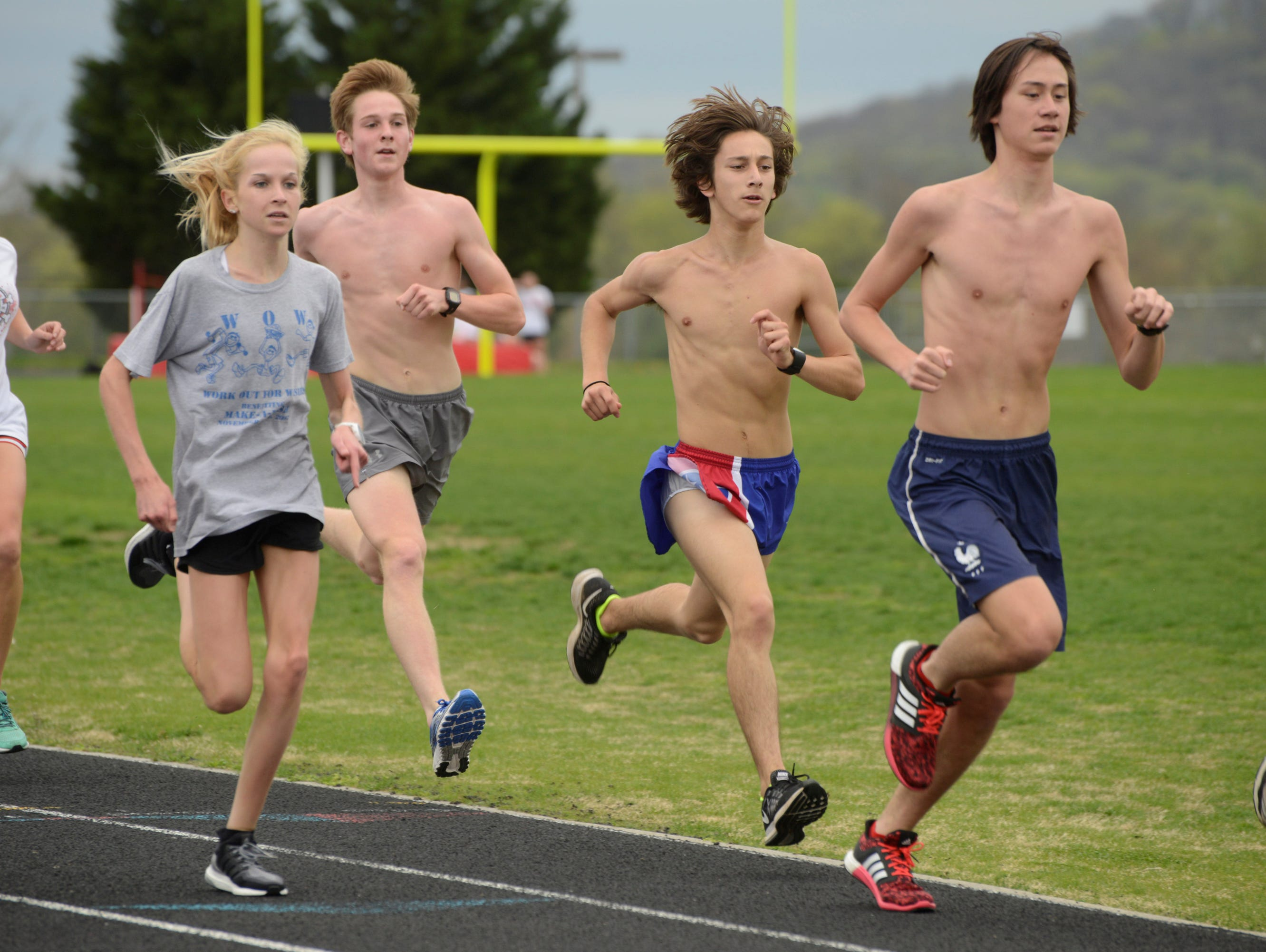 Diego Zuazua (In blue and red shorts) joins track practice on Thurday, March 30, 2016 at Ravenwood High School. Zuazua is a freshmandistance runner who set the half-marathon world record for a 14-year-old earlier this year with a finish at the Cedars of Lebanon race. Originally from Peru, Zuazua identifies as Mexican and is working toward his United States citizenship.