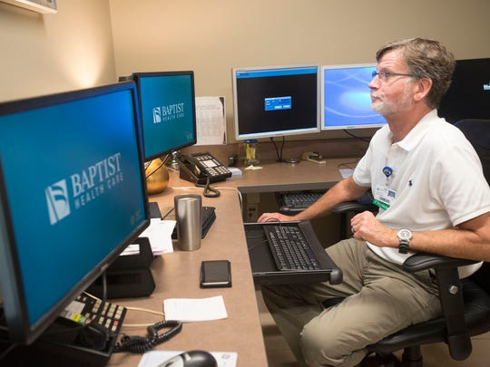 Dr. Andrew Kees read the results of patient's test in the Baptist Health Cares' newly renovated Heart and Vascular Institute.