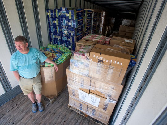 Rev. Tim Meadows works with volunteers as they load a tractor trailer with donated supplies at Woodland United Methodist Church in Pike Road, Ala., on Thursday August 25, 2016. The donated items are being delivered to Baton Rouge for flood victims.