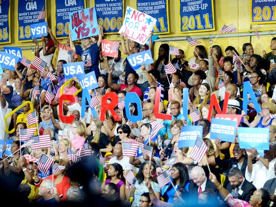 Clinton supporters cheer and hold signs at Johnson C. Smith University at a rally Sept. 8 in Charlotte.