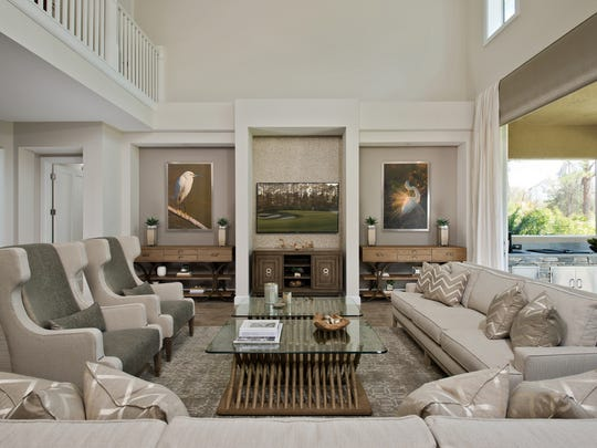 The Egret model, at the Cottages at Old Corkscrew Golf Club, showcases a light neutral color palette with a mix of coastal textures and materials that are in sync with the surrounding natural environment.  This spacious golf cottage is the winner of a 2016 Sand Dollar Award for Interior Design of the Year for a detached single family model home.