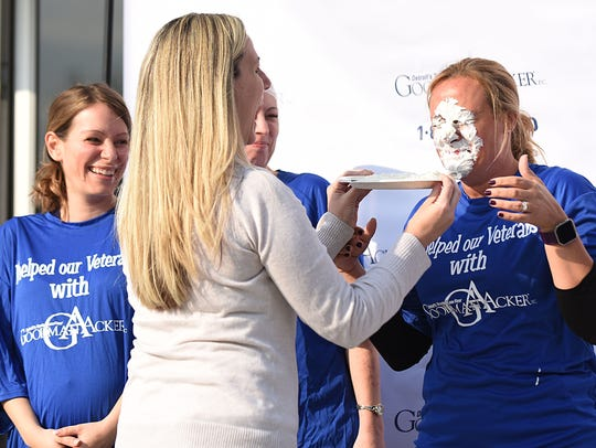 Nicole McGartland takes a pie to Shana Maitland's face.