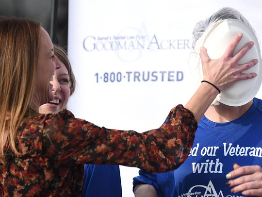 Cyndi Corey (left) puts a pie in Elizabeth Rhodes'