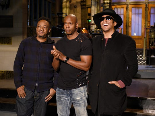 "In this Nov. 10, 2016 photo released by NBC, Jarobi White and Q-Tip of musical guest A Tribe Called Quest pose with host Dave Chappelle, center, on the television show, ""Saturday Night Live,"" in New York. ""Saturday Night Live"" called on host Chappelle's wit for a thoughtful coda to a divisive presidential campaign. Chappelle offered an African-American take on President-elect, Donald Trump's victory over Hillary Clinton, saying he hadn't seen white people so mad since the O.J. Simpson verdict."