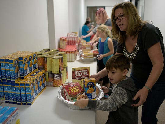 Dominic Freda, 6, and his mother Julie prepare a Thanksgiving