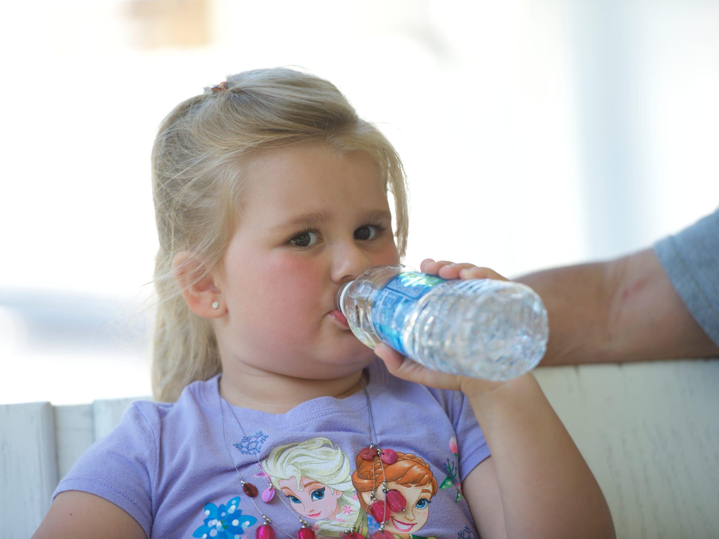 Kailyn Brooke Taylor, 5, of Coal Mountain, W.Va., drinks