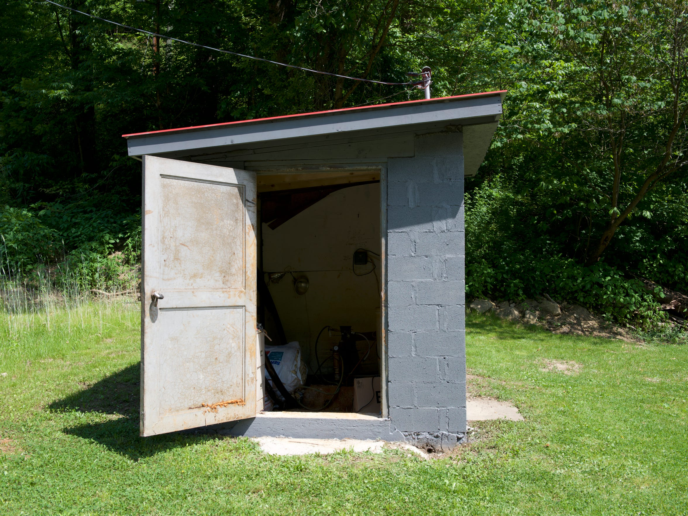 A small shed houses components of the water system