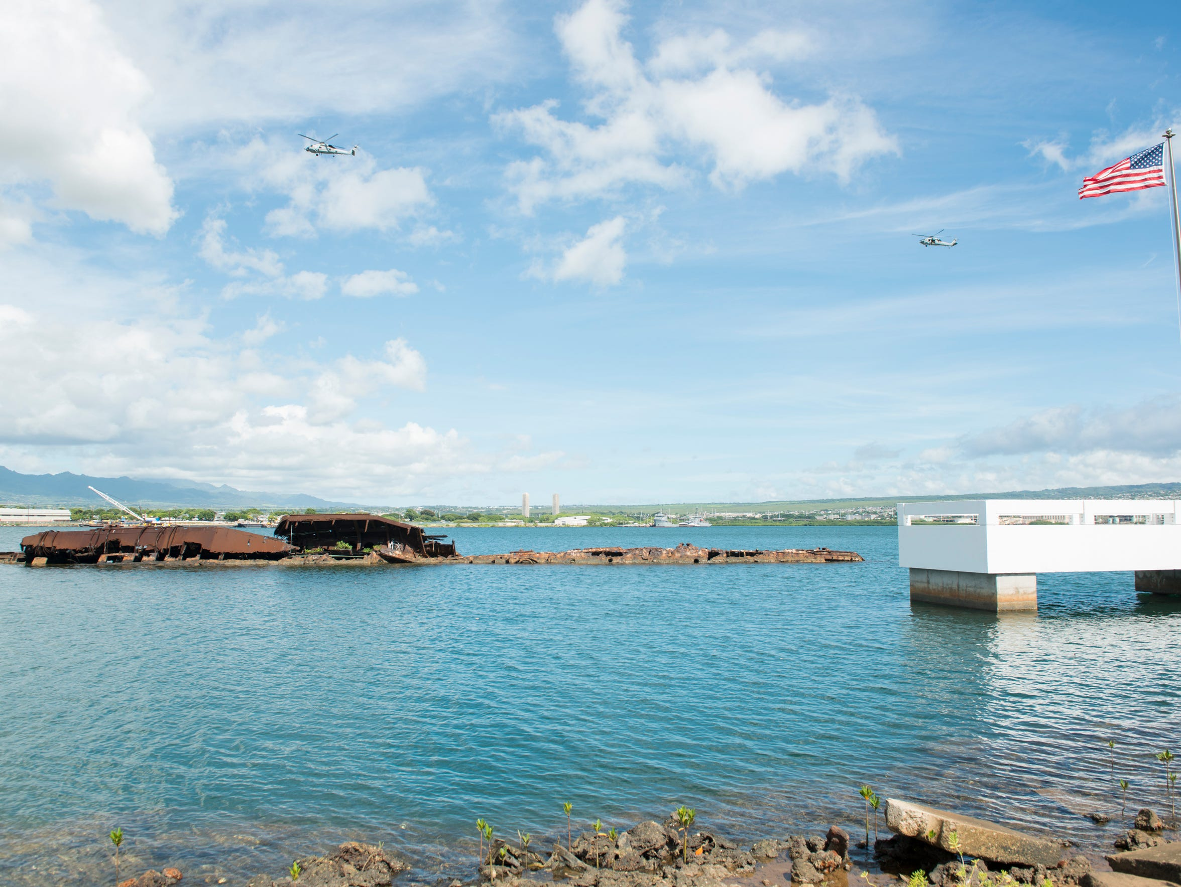 The partially exposed wreckage of the USS Utah lies