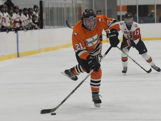 Northville's Nick Bonofiglio (21) aims for a shot on the Brother Rice net during Thursday's game in Oak Park.