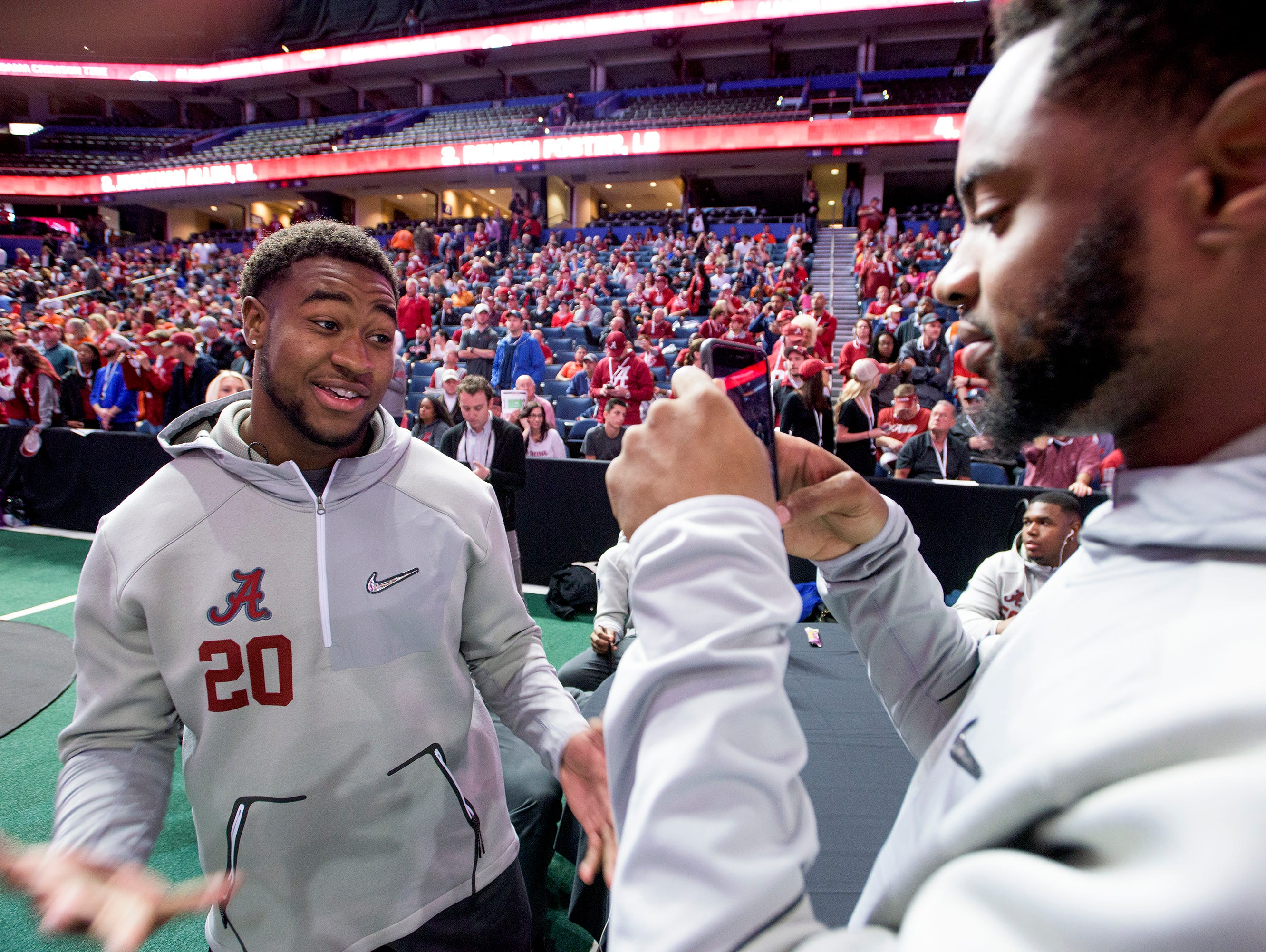 Alabama linebacker Shaun Dion Hamilton (20) is interviewed by linebacker Jamey Mosley (16) during Alabama media Day at Amalie Arena in Tampa, Fla. on Saturday January 7, 2017. The College Football Playoff National Championship Game is on Monday.