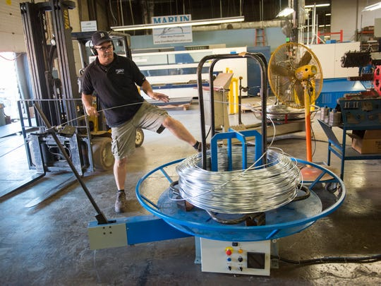 Nathan Myers operates a two-dimensional bending machine that bends steel wire of various thicknesses into a specific radius for Marlin Steel in Baltimore.