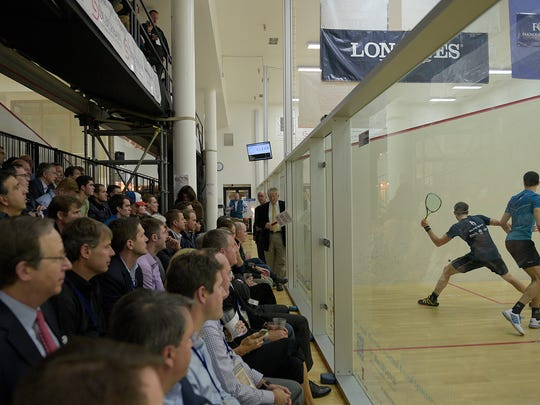 Ali Farag (right) and Ryan Cuskelly compete in the MCO championship match before an attentive crowd crammed into the Birmingham Athletic Club.