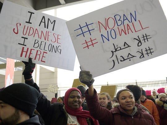 Khadega Mohammed (left) and Julia Wicker of Canton were among protesters recently at Detroit Metro Airport.