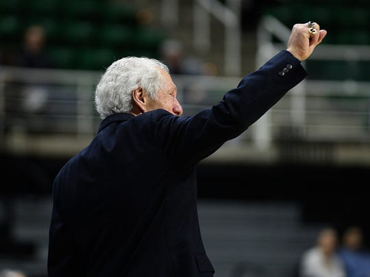 Detroit Country Day head coach Frank Orlando extends a thankful fist pump to the fans who came out to support the girls basketball team in its successful state-title quest at MSU's Breslin Center.