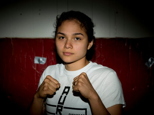 MMA fighter Aurelia Cisneros poses for a portrait in her gym at home on Thursday, April 20, 2017 in Lansing.