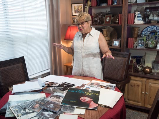 Crystal Joy reflects on her life as a jazz singer and musician while sorting through her scrapbooks, playbills and newspaper clipping on Wednesday, July 19, 2017, at her home in Pensacola.