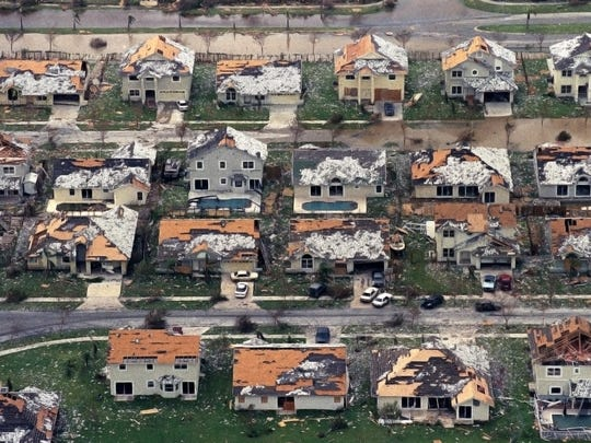 This Aug. 25, 1992, file photo shows rows of damaged houses between Homestead and Florida City, Fla. Two decades after Andrew devastated the area, Homestead and Florida City have doubled in size into a demographically different community, better prepared to deal with hurricanes.