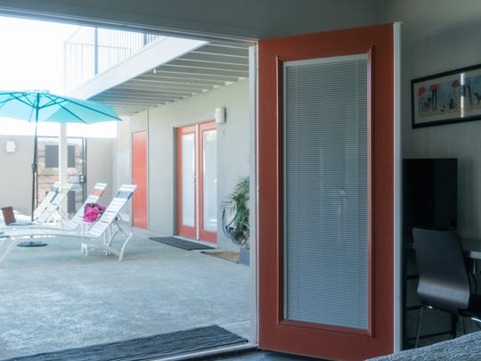 A room at Desert Hot Springs Inn opens onto the deck