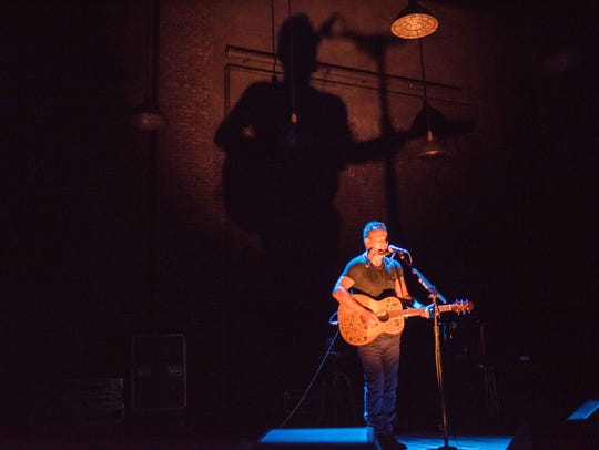 Bruce Springsteen performs in 'Springsteen on Broadway' at the Water Kerr Theatre.