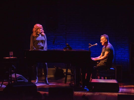 "Patti Scialfa and Bruce Springsteen perform in ""Springsteen on Broadway."" Courtesy of Rob DeMartin"