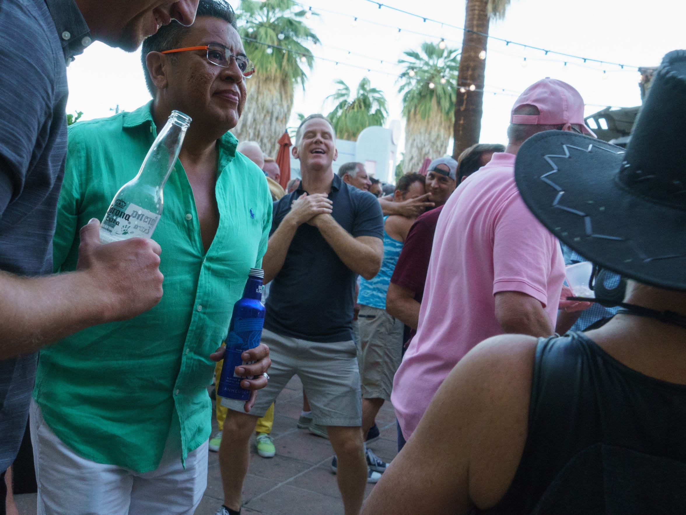 Men dance and mingle at Oscar's weekly tea dance party in downtown Palm Springs on Sunday, Oct. 16.