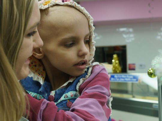 Riley orders ice cream with her cousin Hayley Sweet, La Quinta, Calif., on Dec. 17, 2017. Diagnosed with neuroblastoma in 2016, Riley lost her fight with cancer early Friday.
