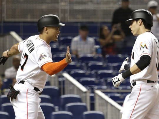 After Giancarlo Stanton, left, was traded to the Yankees, Westlake High graduate Christian Yelich made it clear he didn't want to be part of rebuilding process in Miami. The Marlins traded the center fielder to the Milwaukee Brewers on Thursday.