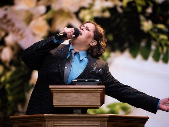 Playwright Anna Deavere Smith performs as Jamal Harrison