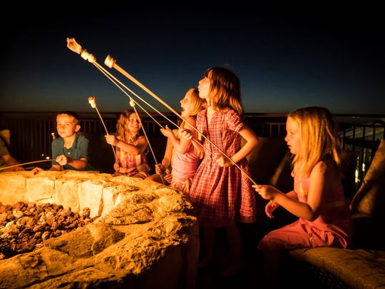 Warming up to the fire pit for a marshmallow roast is a fun, tasty time for families and younger visitors to Crystal Springs Resort.