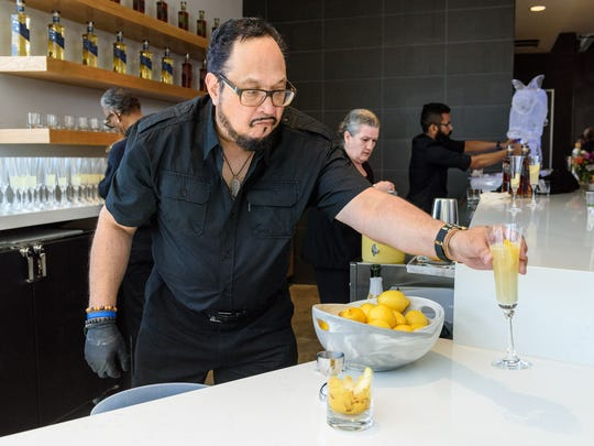 Bartender Kip Mackey serves a French 75 at Rabbit Hole Distillery, at 711 E. Jefferson Street in NuLu, as they host a ribbon-cutting, grand opening party and a peek inside before opening to the public sometime in June. May 1, 2018